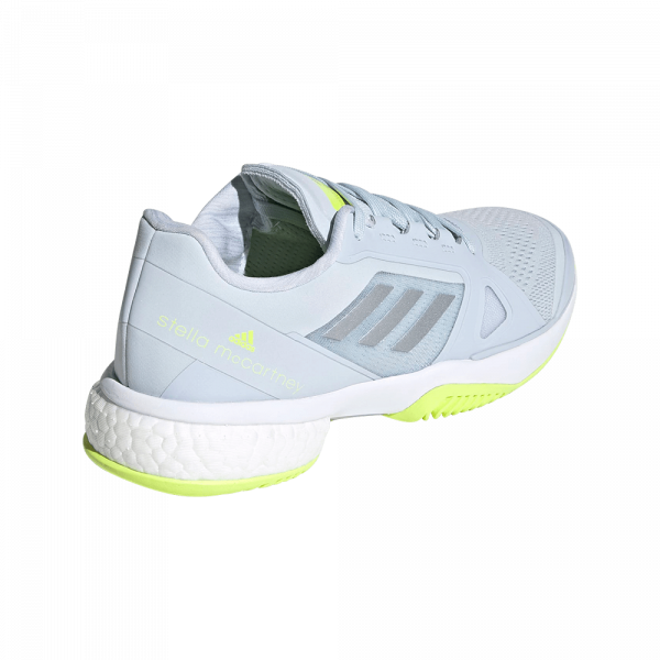 adidas by Stella McCartney Barricade Boost Halo Blue/Solar Yellow. Blue and yellow padel shoes from adidas by Stella McCartney.